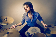 Man and drums. Man is playing the drums stock photography