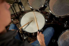 Man playing drums at concert or music studio Stock Images