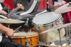 Man playing drums. A man playing drums in front of a microphone Stock Photos