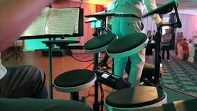 Man playing drums in a musical group, live performance. Drummer on stage. Close-up.  stock footage