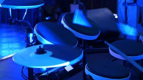 Man playing drums in a musical group, live performance. Drummer on stage. Close-up.  stock video footage