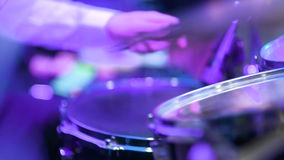 Man playing drums during rock concert stock video
