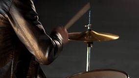 A man playing drums at rock group repetition. Mid shot