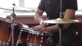 Man playing drums in the studio. Skilled drummer stock footage