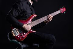 Playing Electric Bass Guitar with Slap Technique stock photos