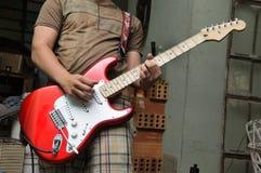 Man playing electric guitar Stock Photos
