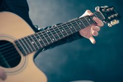 Man playing on electric guitar. Royalty Free Stock Photography