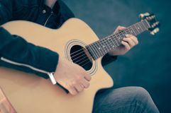 Man playing on electric guitar. Royalty Free Stock Images