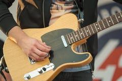 Man playing electric guitar. Close up Stock Photography