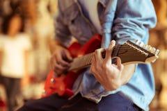 Man playing electric guitar Stock Image
