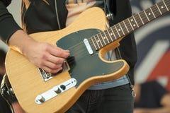 Man playing electric guitar. Close up Stock Photo