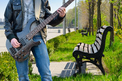 A man playing the electric guitar in the park Stock Photo