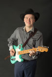 Man playing the electric guitar Stock Photography