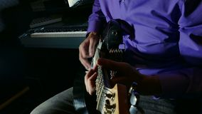 Man playing electric guitar recording studio pulls the strings stock video