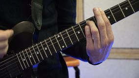Man Playing on Electric Guitar. Slow Motion Instrument Playing Band of Men.  stock footage