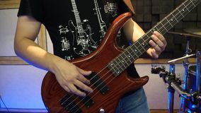 Man Playing on Electric Guitar. Slow Motion Instrument Playing Band of Men.  stock video footage