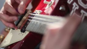 Man playing electric guitar using tremolo technique stock video footage