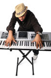 Man Playing Electric Keyboard. African American man playing electric keyboard backwards Royalty Free Stock Images