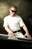 Man playing electric piano Royalty Free Stock Image