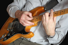 Man playing electrical guitar Royalty Free Stock Photography