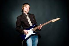 Man playing electro guitar. Studio shot Stock Photos