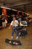 Man playing erhu - busking. Man playing erhu in New York subway station - busking Stock Images