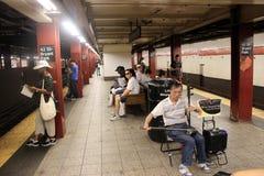 Man playing erhu - busking. Man playing erhu in New York subway station - busking Royalty Free Stock Image