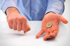 Man playing with euro coin. Royalty Free Stock Images