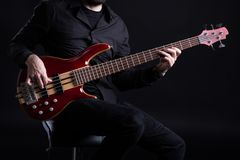 Man Playing Five String Bass stock photos