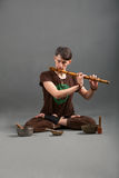 Man playing the flute, singing bowls. And tools for meditation Stock Photos