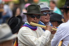 Man playing flute in the street Royalty Free Stock Image