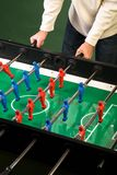 Man playing foosball table game Royalty Free Stock Photos