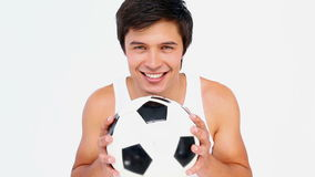 Man playing with a football. Against white background stock video