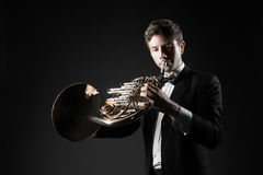 Man playing French horn Stock Images