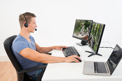 Man Playing Game On Computer Stock Photo