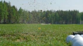 Man playing game of golf. Man hitting Golf ball stock image