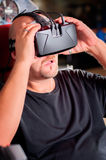 Man playing game in virtual reality glasses Stock Images
