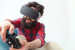 Man playing the game in VR headset royalty free stock image