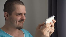 Man playing in games on smartphone stock video footage