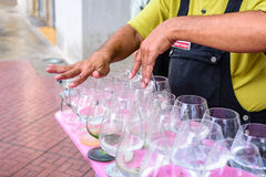 Man is playing a glass harp Royalty Free Stock Photos