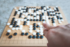 Man playing Go board game Royalty Free Stock Photo