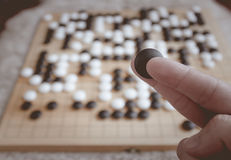 Man playing Go board game Royalty Free Stock Images