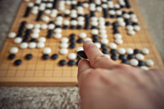 Man playing Go board game Stock Photos