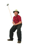 Man playing golf #1. Man playing golf, aiming to take a swing with his club Stock Images