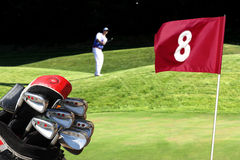 Man playing golf. With golf bag Stock Photos