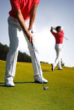 Man playing golf Stock Image