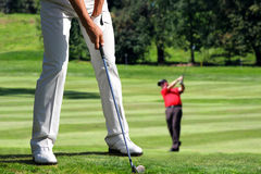 Man playing golf Stock Images