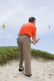 Man playing golf Stock Photography