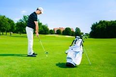 Man Playing Golf Stock Photos