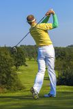 Man playing golf against blue sky Royalty Free Stock Images